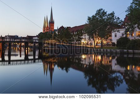 Lubeck cityscape at dusk with Obertrave river, Marienkirche and Petrikirche churches