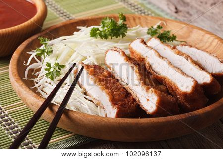Japanese Food: Breaded Deep Fried Pork Tonkatsu With Cabbage And Sauce