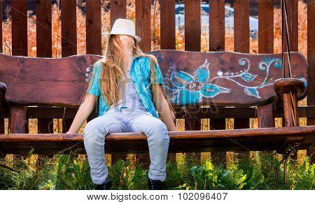 Girl On Garden Swing
