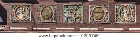 Traditional Carving At An Half Timbered House With Symbols
