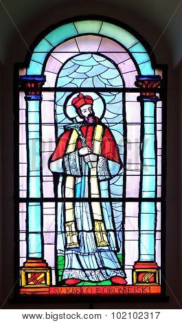 PAKRAC, CROATIA - MAY 07: Saint Chaeles Borromeo, stained glass window in the Church of the Assumption of the Blessed Virgin Mary in Pakrac, Croatia on May 07, 2015