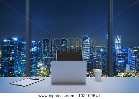 A Workplace In A Modern Panoramic Office With New York Evening View. A White Table, Black Leather Ch