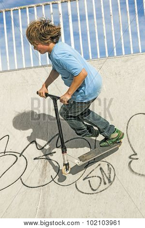 Boy With Scooter Is Going Airborne