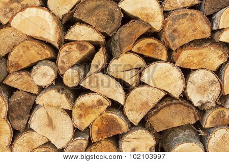 Background of stacked wood. Ready firewood.