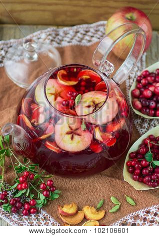 Fruit tea from apples, cranberries, cowberry  and cardamom. Hot Christmas drink