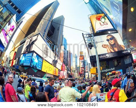 NEW YORK,USA - AUGUST 14,2015 : Tourists and locals crowd at famous Times Square in New York City
