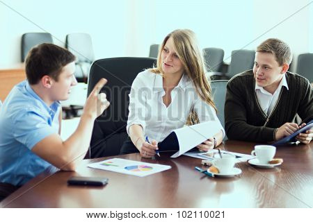 Young Beautiful Business Woman With Business Partners, Men At A Business Meeting