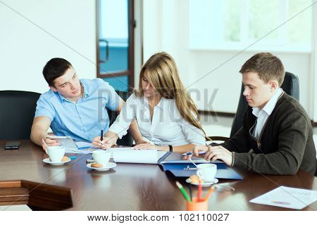 Young Beautiful Business Woman Executive With Business Partners, Men At A Business Meeting