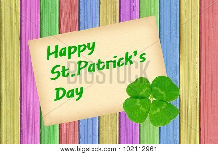 Happy St Patrick's Day Card On Painted Color Wooden Texture Close-up