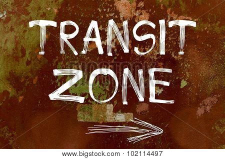 Transit zone written over old painted wall