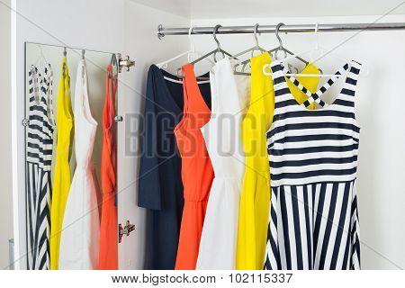 Series Of Bright Modern Fashion Women Dresses On Hangers