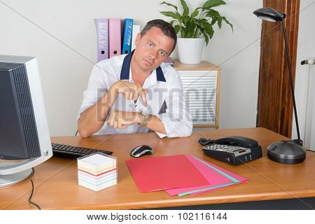 Picture Of A Boss  At Work Having Conflict Showing His Watch.