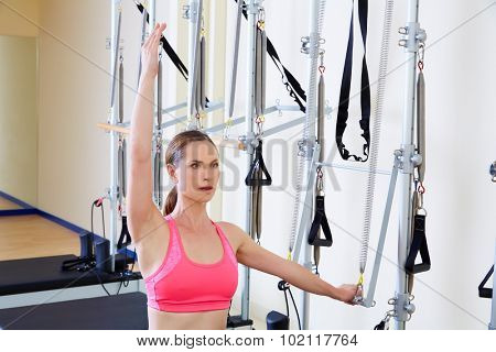Pilates reformer woman side push through exercise workout at gym indoor