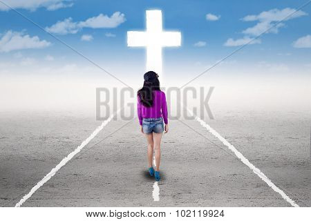 Girl In A Spiritual Journey With A Cross