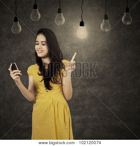 Girl Using Cellphone Under Lamps