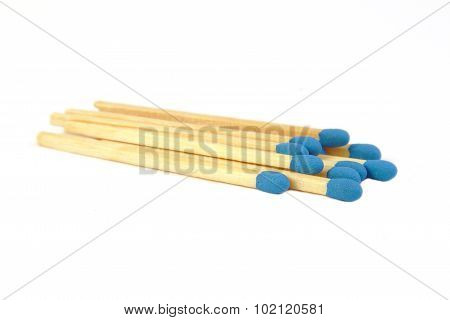 Some blue matches isolated on white background