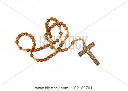 Wooden rosary with cross isolasted on a white background