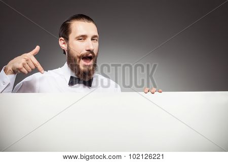 Attractive young man with beard is advertising placard