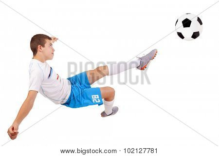 Professional soccer player making a acrobatic kick, isolated on white background