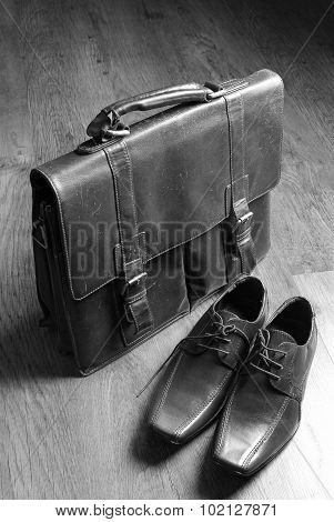 briefcase and leather shoes