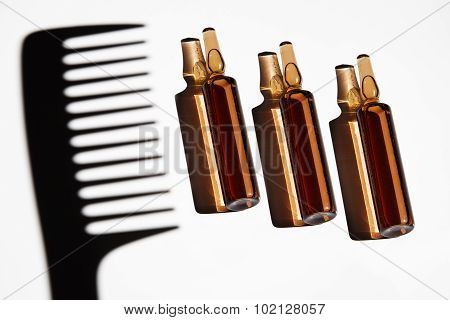 Set Of Ampules With A Shadow Of Hair Comb
