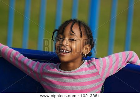 Young Girl Playing In Park