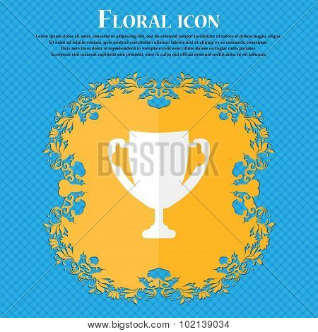 Winner Cup Sign Icon. Awarding Of Winners Symbol. Trophy. Floral Flat Design On A Blue Abstract Back