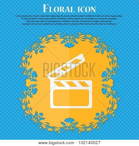 Cinema Clapper  Sign Icon. Video Camera Symbol. Floral Flat Design On A Blue Abstract Background Wit