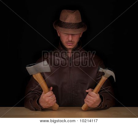 Man with hatchet and hammer