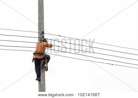 Thai Worker On Electric Pole For Install New Cable Isolated On White