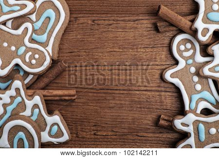 Tray of decorated gingerbread cookies with cinnamon sticks