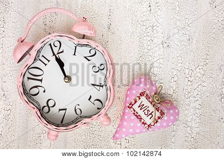 Retro Pink Clock And Soft Pink Heart With Word Wish On Wooden Background, Top View