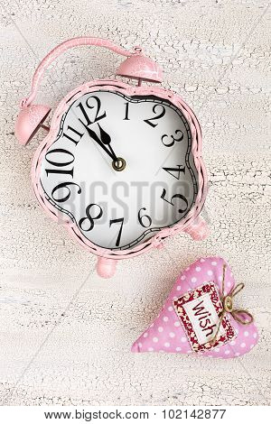Retro Pink Clock And Soft Pink Heart With Word Wish On Wooden Background, Top View, Vertical Composi