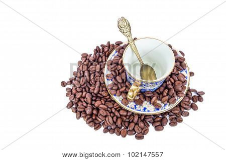 Classic luxury porcelain cup and roasted coffee bean, isolated on white background