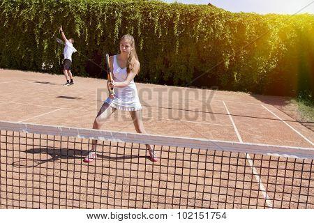 Two athletes on tennis court