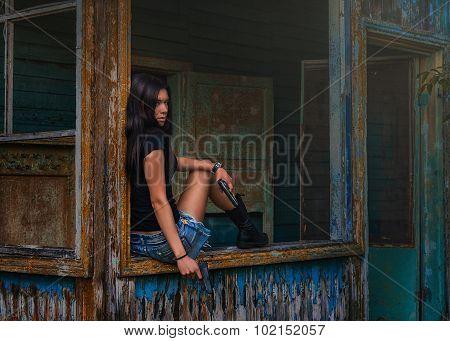 Beautiful young woman with two gun