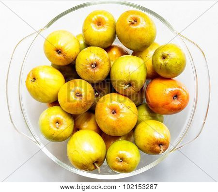 Closeup of Indian jujube fruit kept in a glass bowl on a plain background