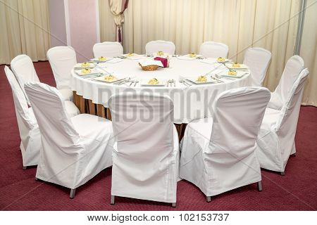 Photo Round Dining Table Served For Twelve People.