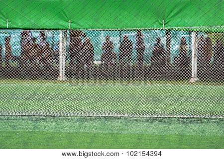 Unrecognizable Audience Watching Kids Soccer Game