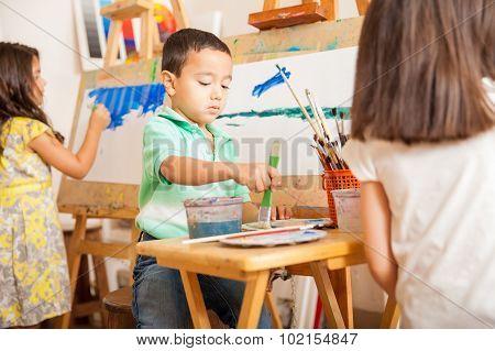 Little Kids Painting In Art Class