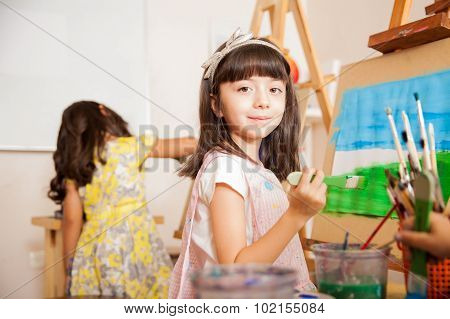 Cute Girl Working On A Painting