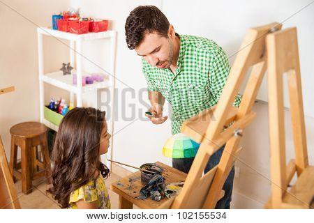 Little Girl Listening To Her Art Teacher