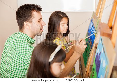 Art Teacher Painting With Students
