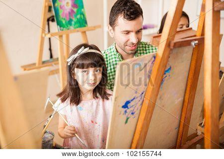 Pretty Girl And Her Teacher In Art Class