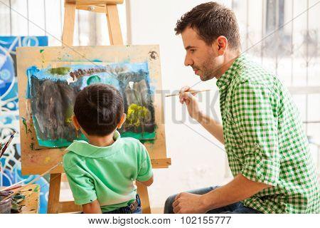 Young Art Teacher Doing His Job