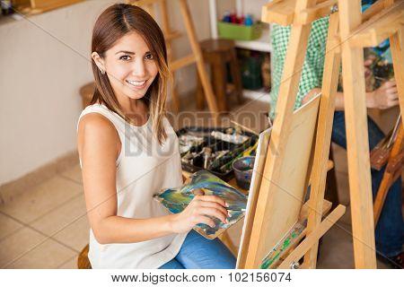 Hispanic Woman Enjoying Art School