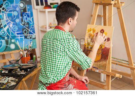 Male Artist Working In His Studio