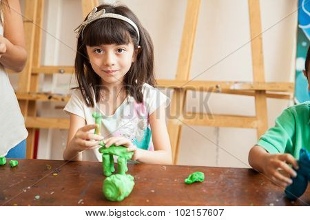 Cute Girl Sculpting With Clay