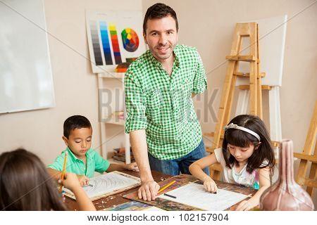 Hispanic Art Teacher With His Students