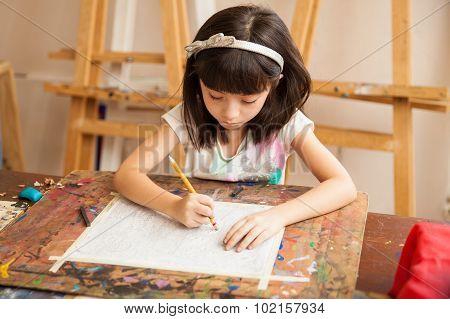 Little Girl Drawing In Art Class